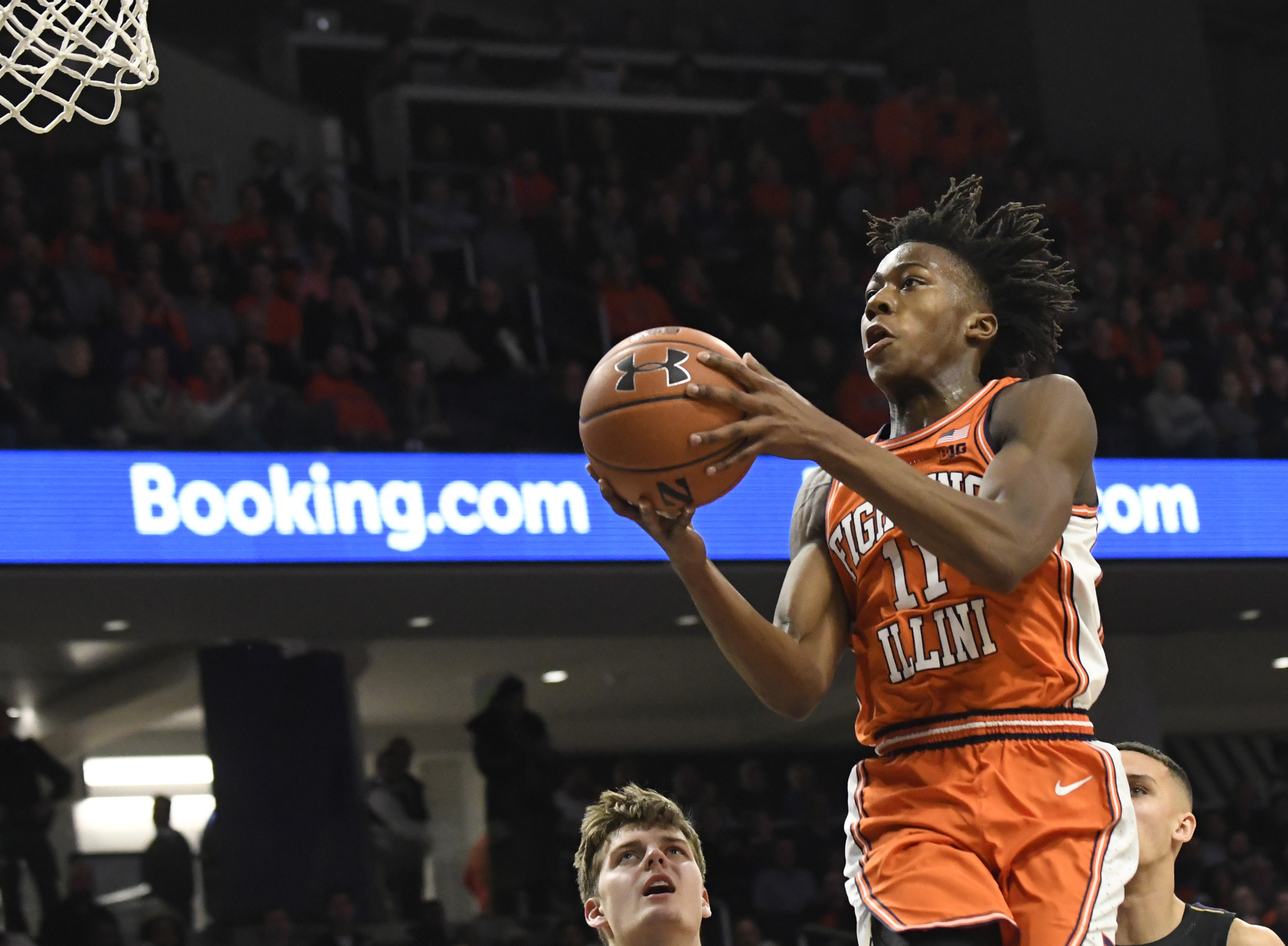 Feb 27, 2020; Evanston, Illinois, USA; Illinois Fighting Illini guard Ayo Dosunmu (11) goes to the basket against the Northwestern Wildcats during the first half at Welsh-Ryan Arena.