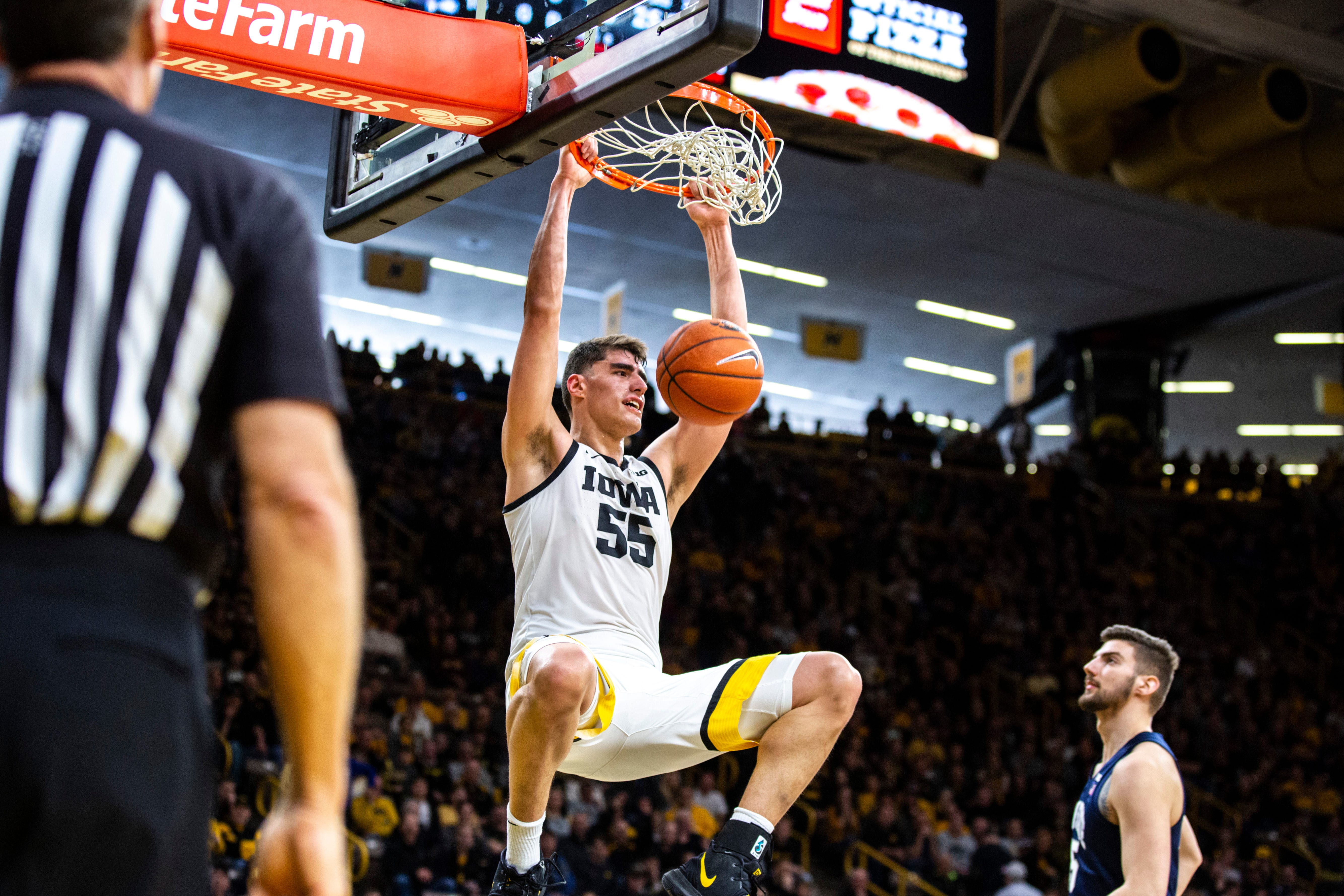 Iowa center Luka Garza (55) dunks during a NCAA Big Ten Conference mens basketball game against Penn State, Saturday, Feb. 29, 2020, at Carver-Hawkeye Arena in Iowa City, Iowa. 200227 Penn St Iowa Mbb 046 Jpg
