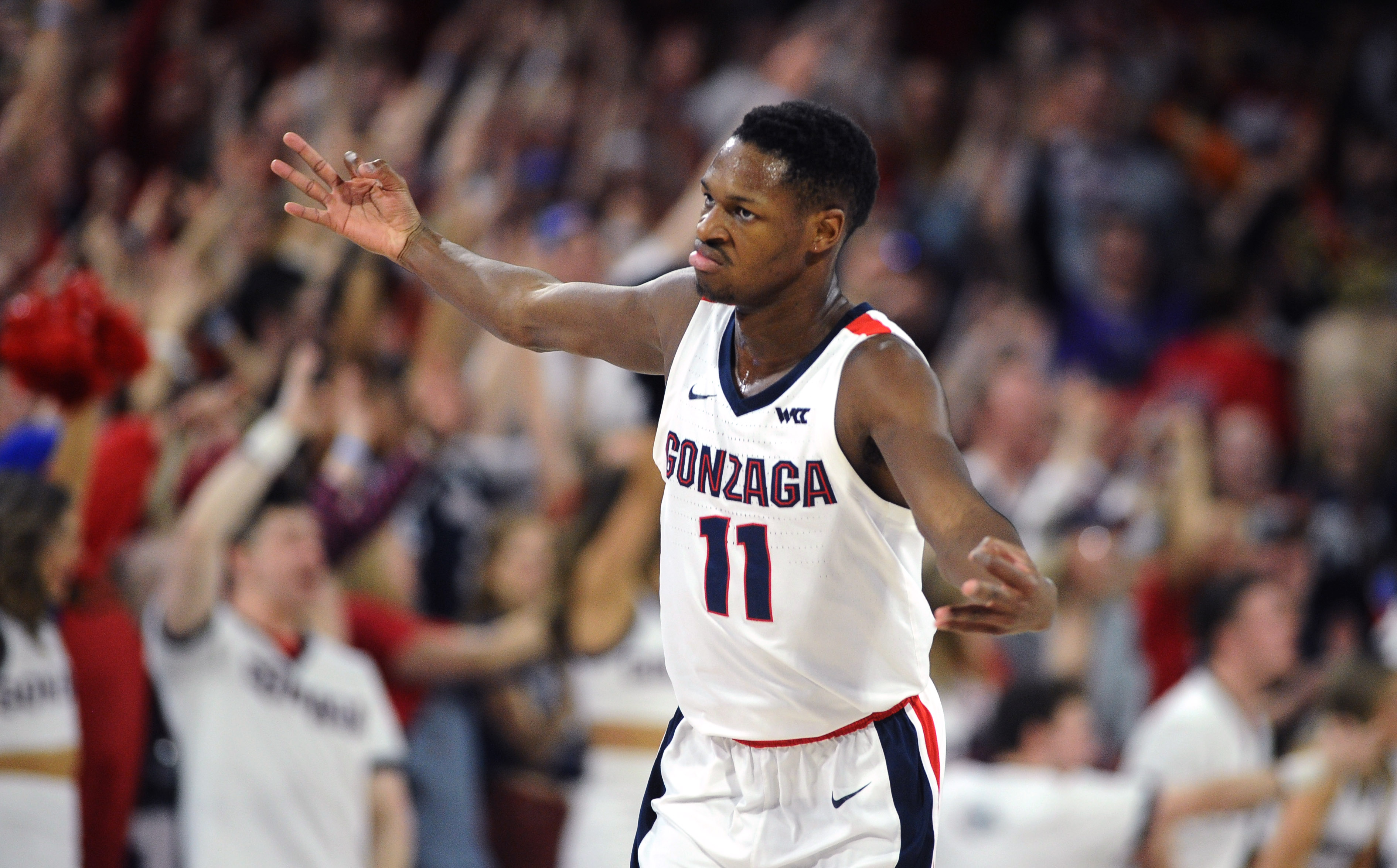 Feb 29, 2020; Spokane, Washington, USA; Gonzaga Bulldogs guard Joel Ayayi (11) celebrates a three-pointer against the St. Mary's Gaels in the second half at McCarthey Athletic Center. The Bulldogs won 86-76.