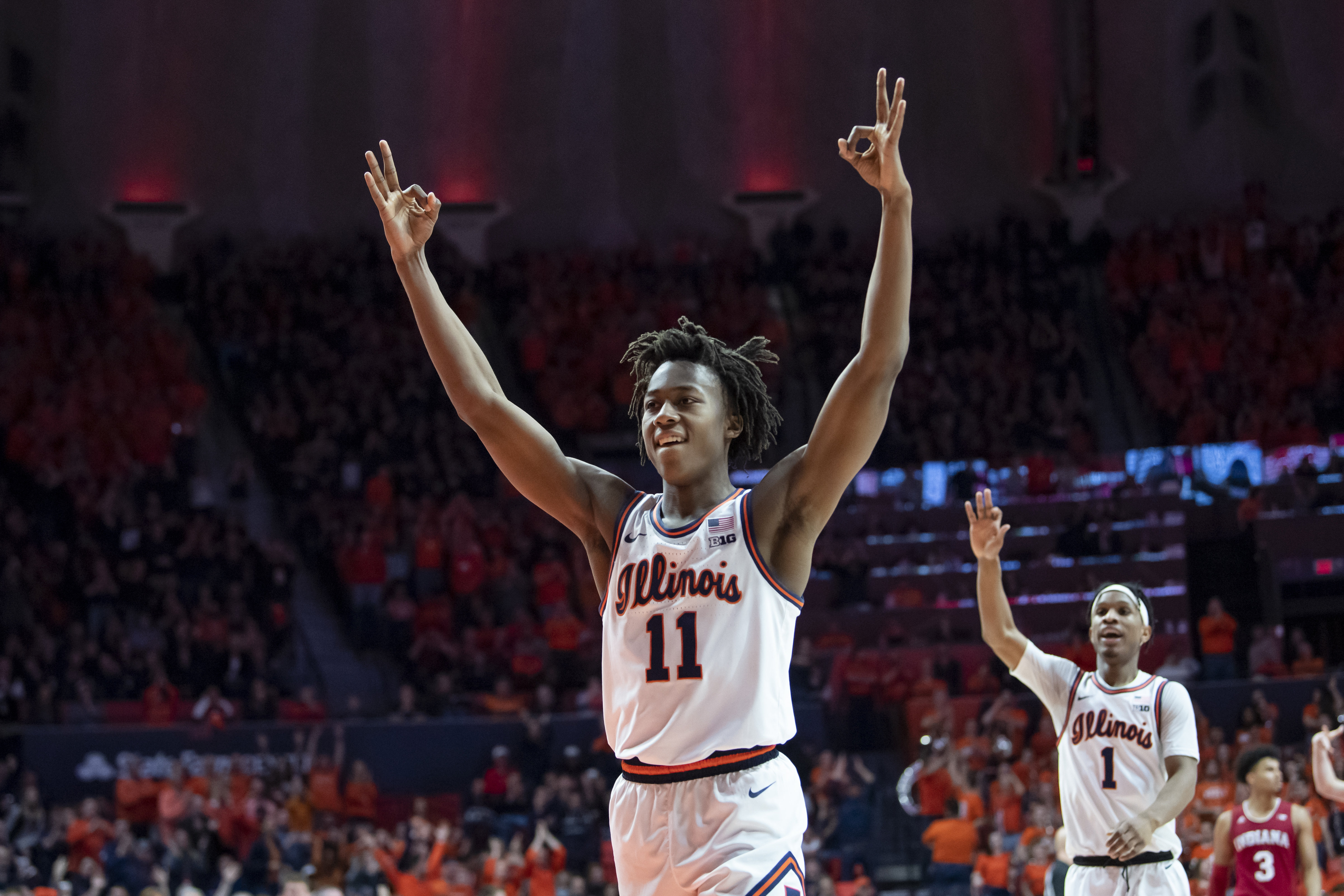 Mar 1, 2020; Champaign, Illinois, USA; Illinois Fighting Illini guard Ayo Dosunmu (11) celebrates his three point shot during the second half against the Indiana Hoosiers at State Farm Center.