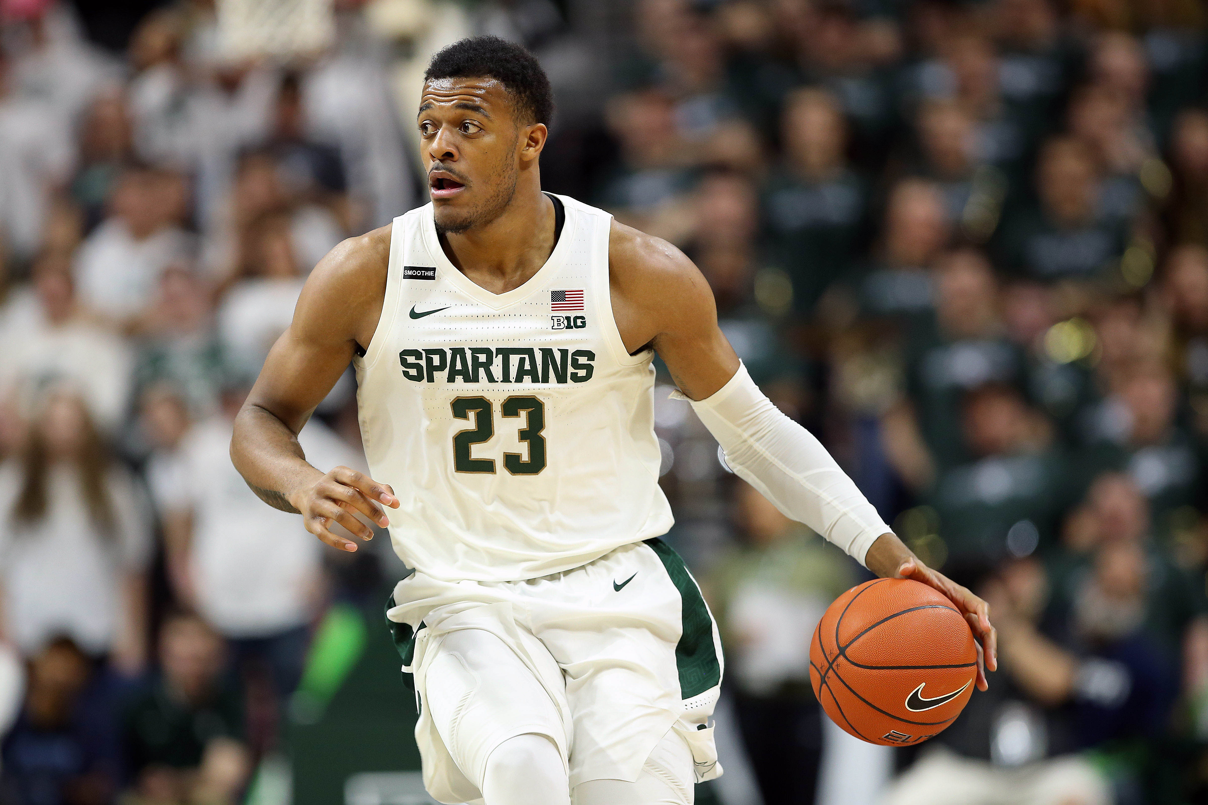 Feb 25, 2020; East Lansing, Michigan, USA; Michigan State Spartans forward Xavier Tillman (23) brings the ball up court during the second half a game against the Iowa Hawkeyes at the Breslin Center.