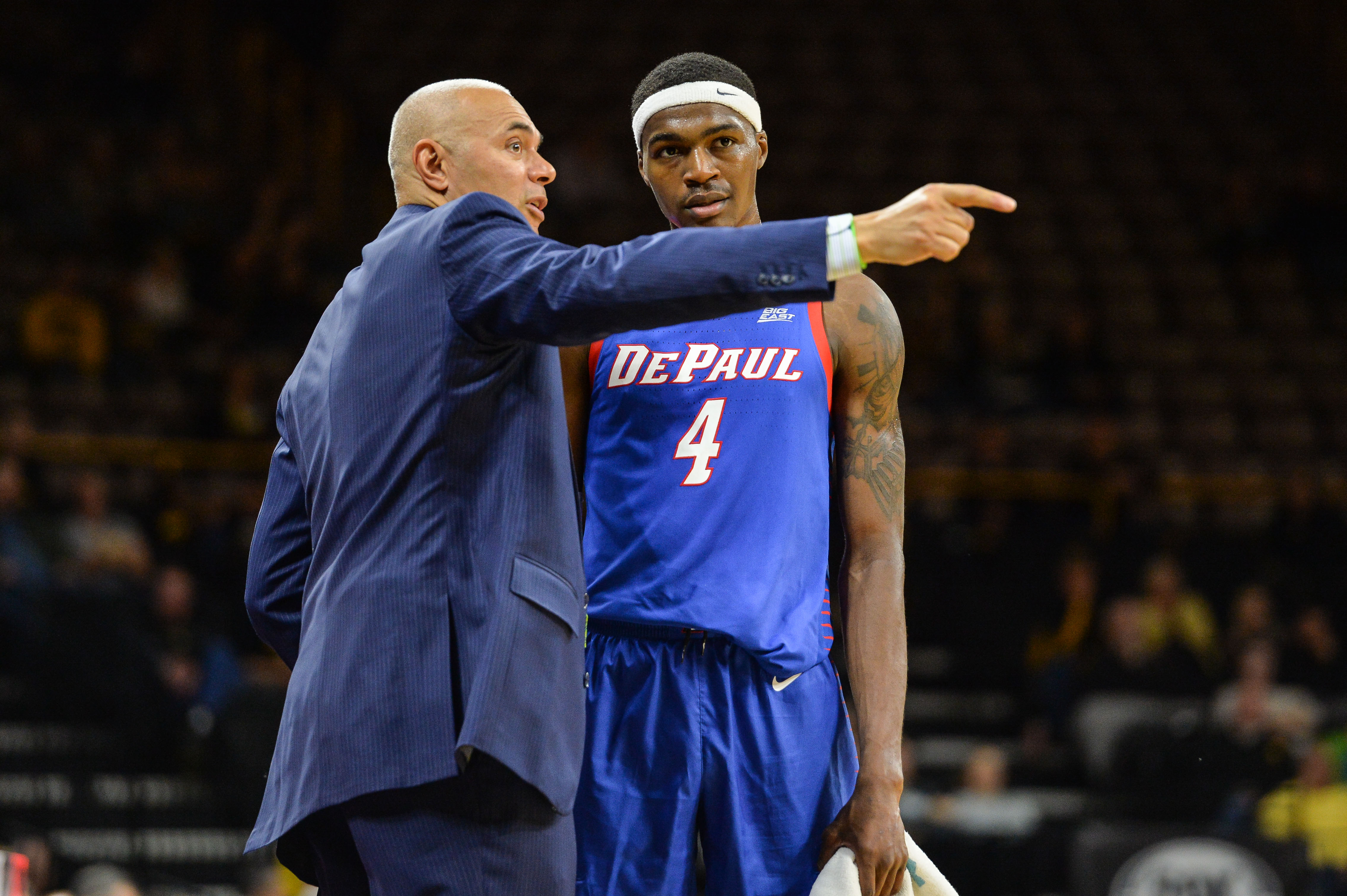 Nov 11, 2019; Iowa City, IA, USA; DePaul Blue Demons head coach Dave Leitao talks with forward Paul Reed (4) during the second half against the Iowa Hawkeyes at Carver-Hawkeye Arena.