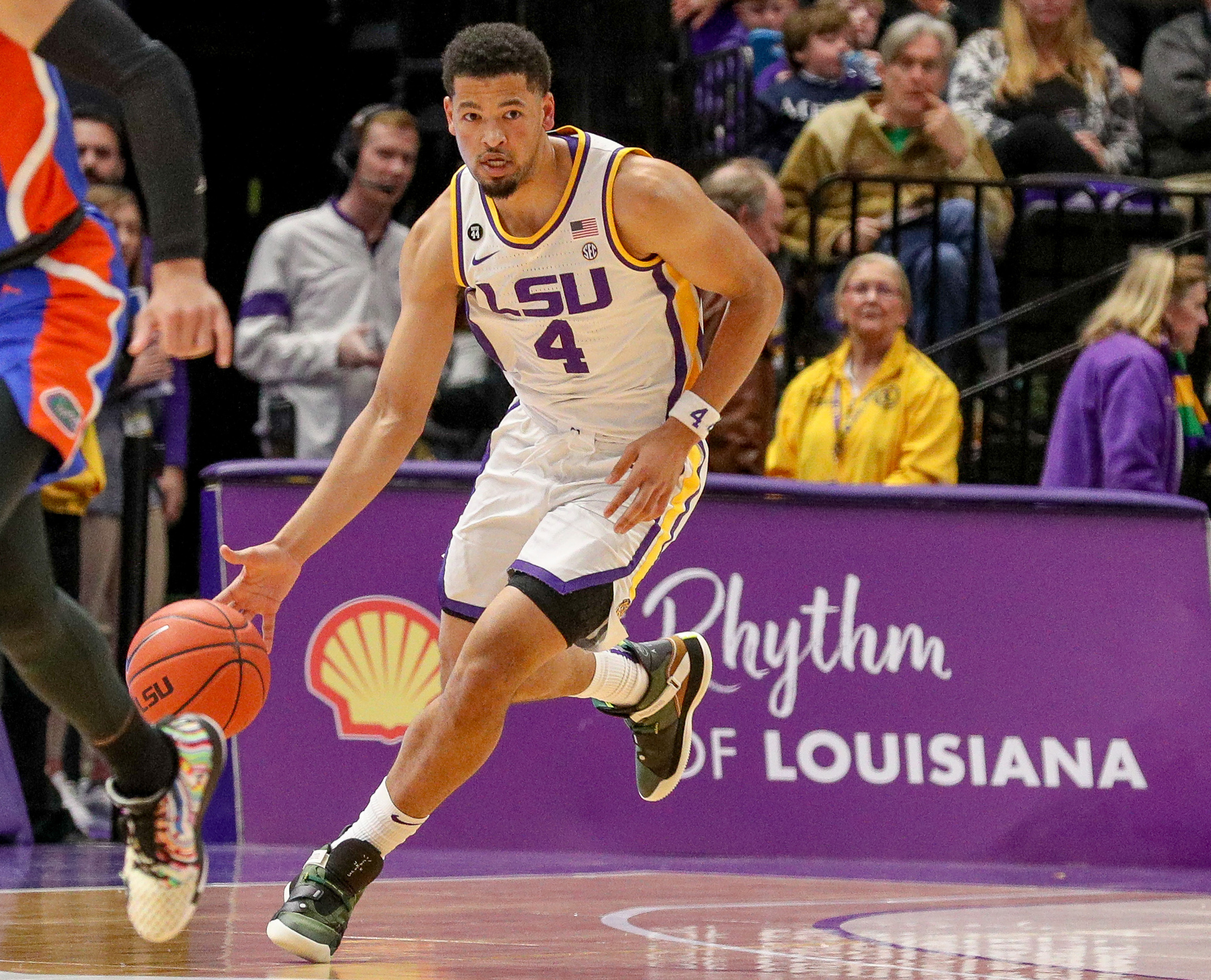 Jan 21, 2020; Baton Rouge, Louisiana, USA; LSU Tigers guard Skylar Mays (4) brings the ball up court against the Florida Gators during the first half at Maravich Assembly Center.