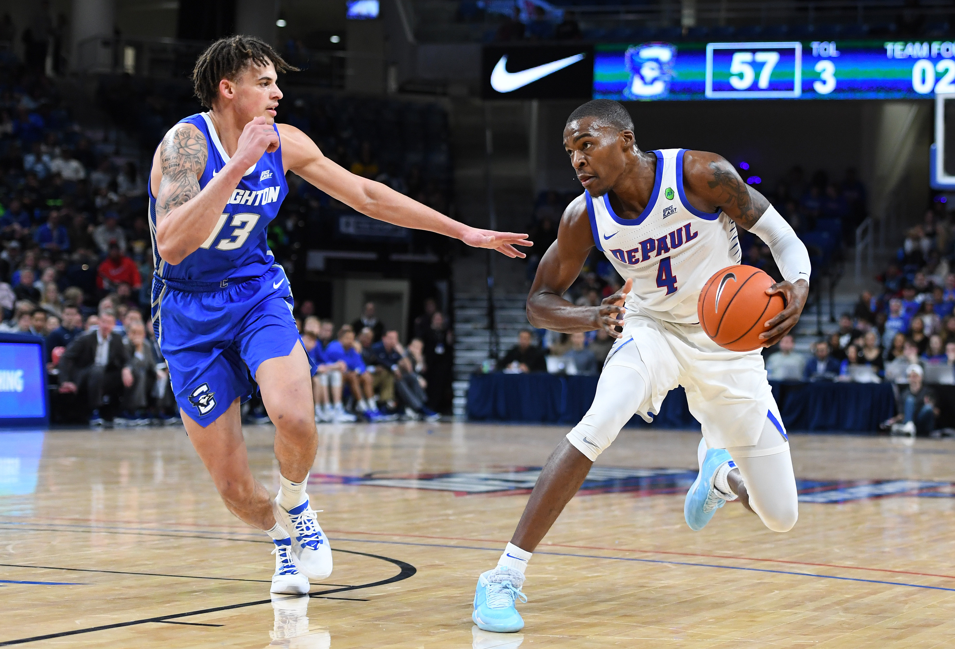 Jan 25, 2020; Chicago, Illinois, USA; DePaul Blue Demons forward Paul Reed (4) dribbles the ball against Creighton Bluejays forward Christian Bishop (13) during the second half at Wintrust Arena. Mandatory Credit: