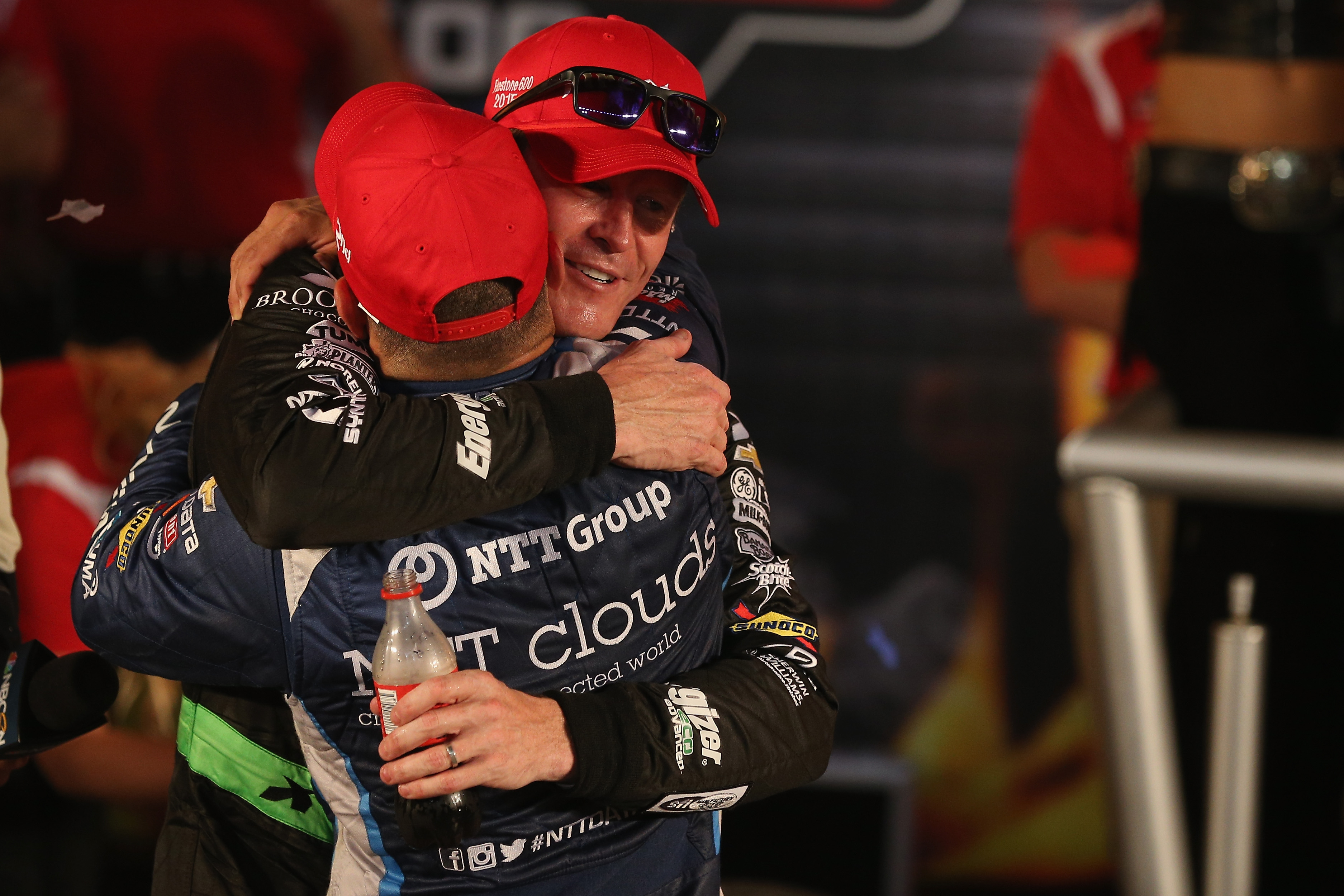 Tony Kanaan (foreground) congratulates Chip Ganassi Racing teammate and race winner Scott Dixon. (Photo by Patrick Smith/Getty Images for Texas Motor Speedway)