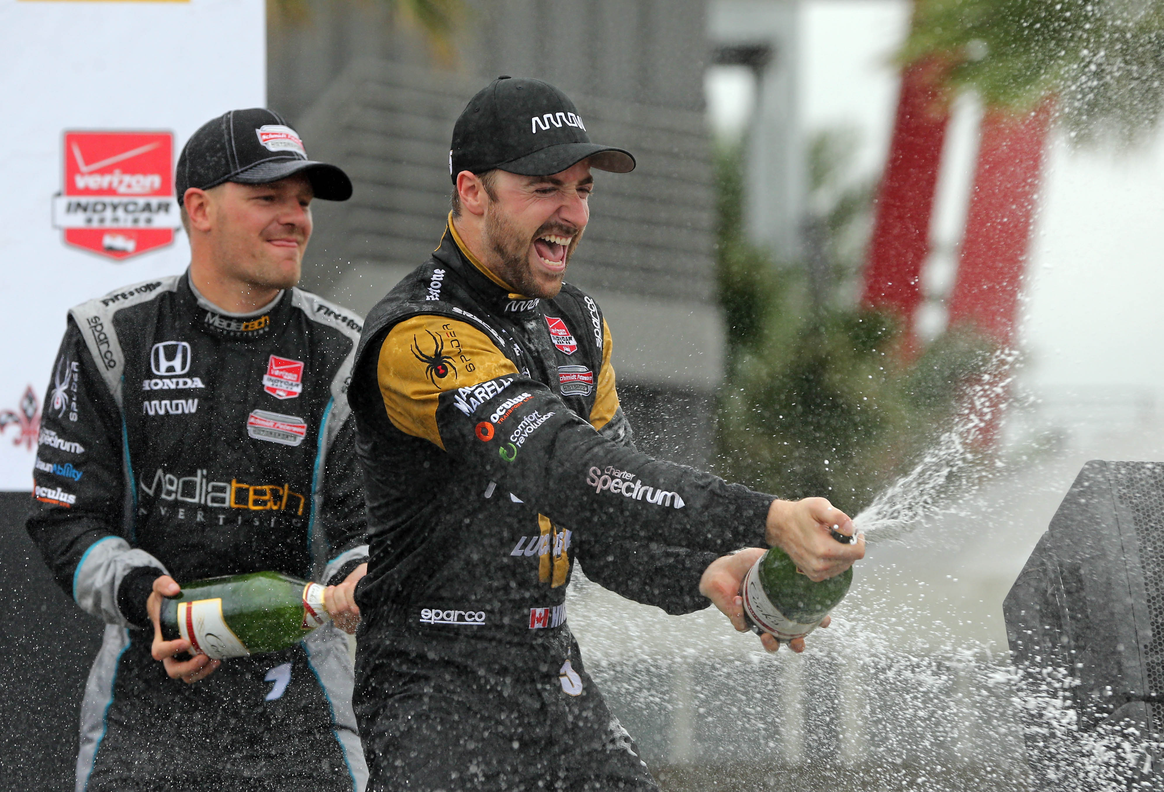 James Hinchcliffe, right, celebrates with third-place finisher James Jakes after winning at the Grand Prix of Louisiana on April 12. (Chuck Cook, USA TODAY Sports)