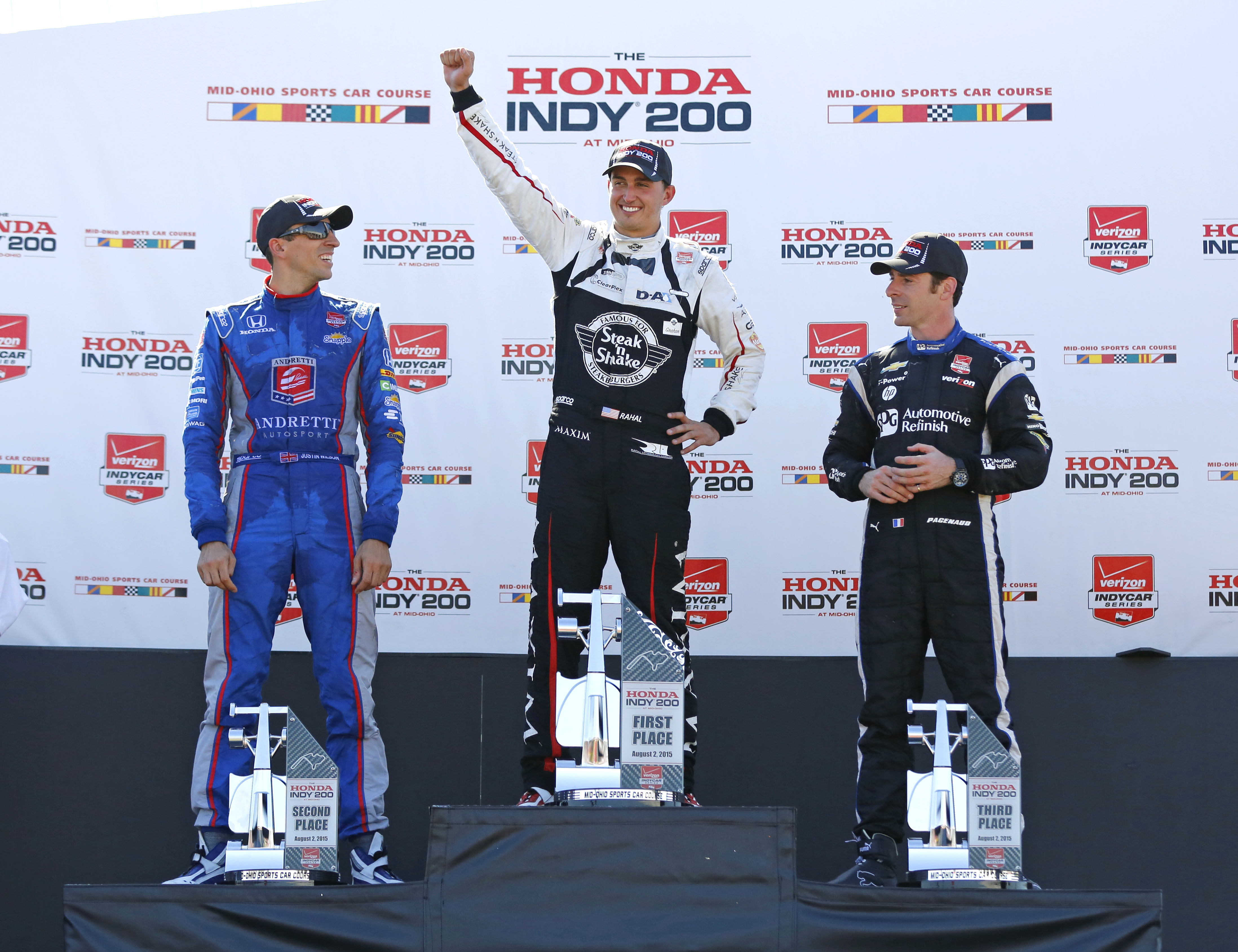 Graham Rahal, center, celebrates on the podium at Mid-Ohio with runner-up Justin Wilson, left, and third-place finisher Simon Pagenaud. (Aaron Doster, USA TODAY Sports)