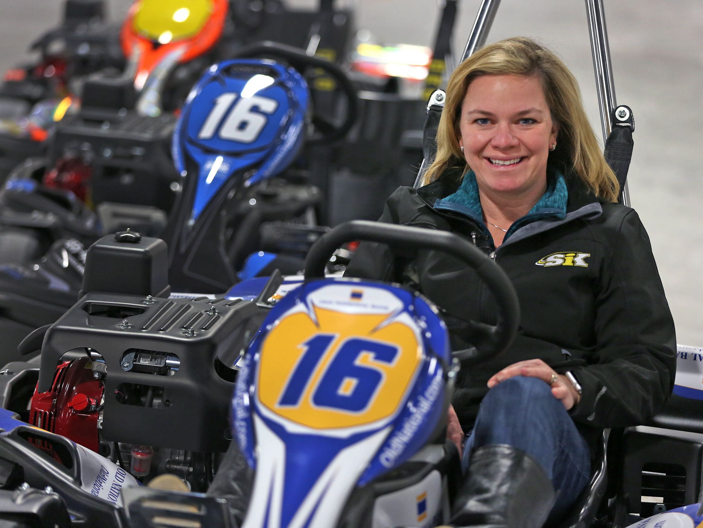 Former IndyCar driver Sarah Fisher sits in a go-cart at her soon-to-open Speedway business, Speedway Indoor Karting.