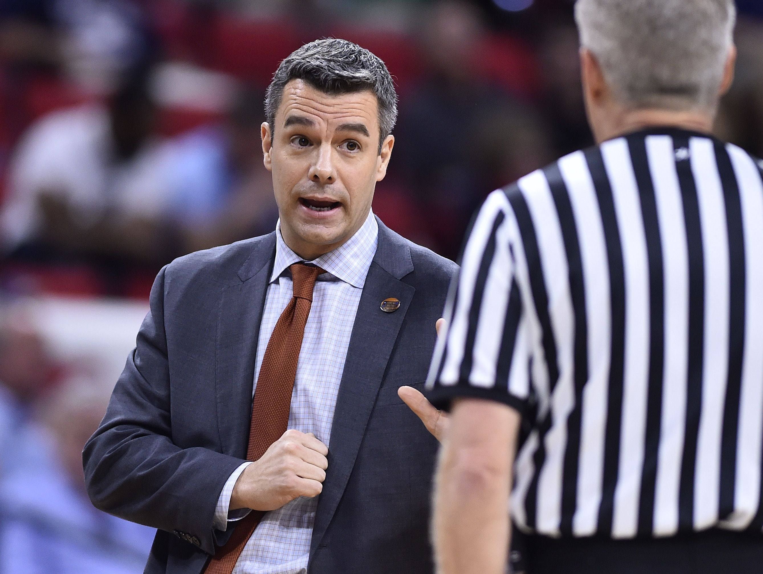 Virginia Cavaliers head coach Tony Bennett (L) questions a call against the Hampton Pirates during the first half at PNC Arena.