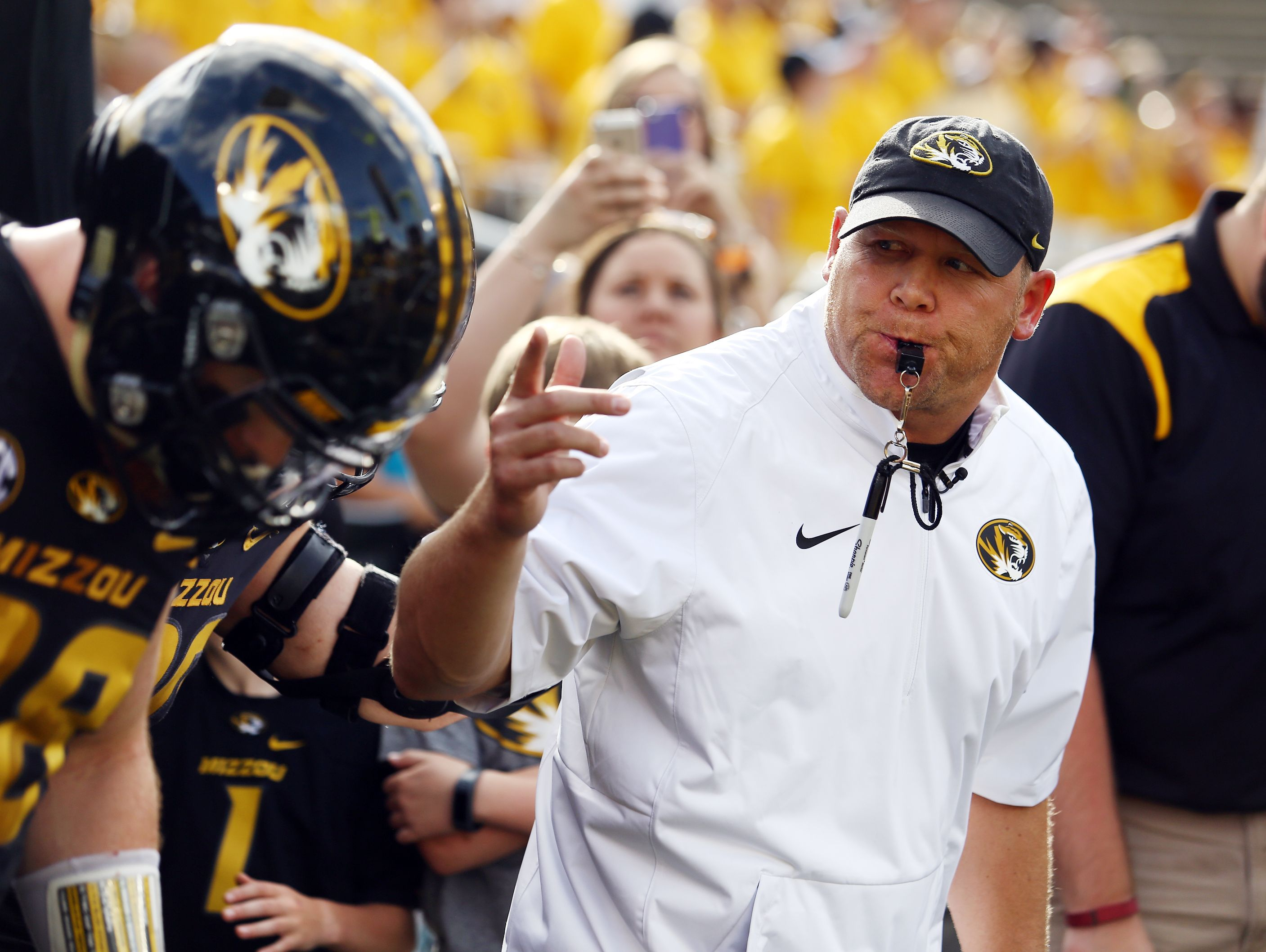 Missouri football coach Barry Odom leads the team onto the field for the Black and Gold spring game.