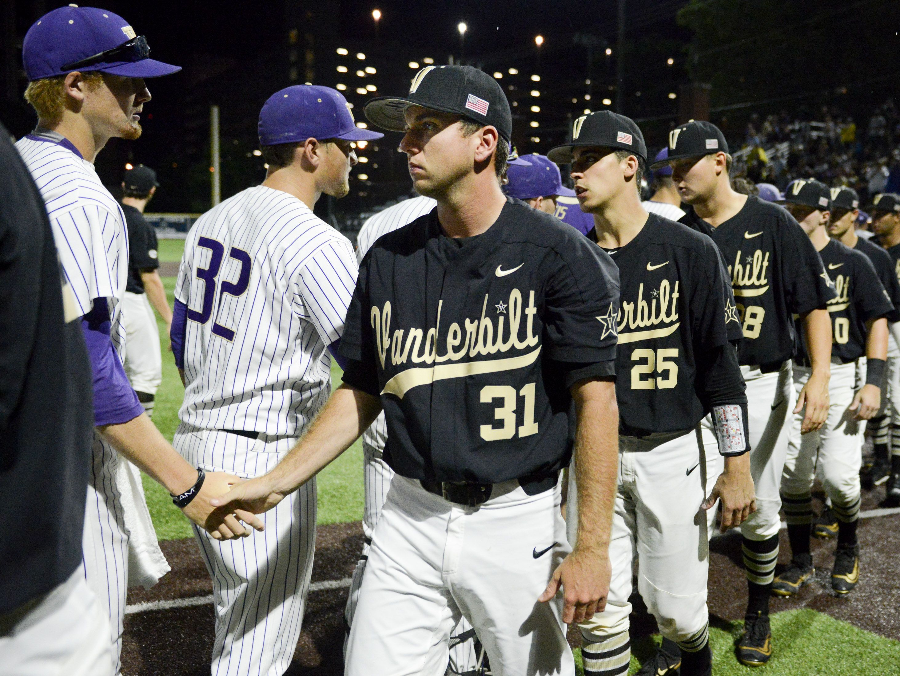 Vanderbilt pitcher Ryan Johnson (31) shakes hands with Washington players after the Commodores' 9-8 loss in the NCAA Regional on Saturday night at Hawkins Field.