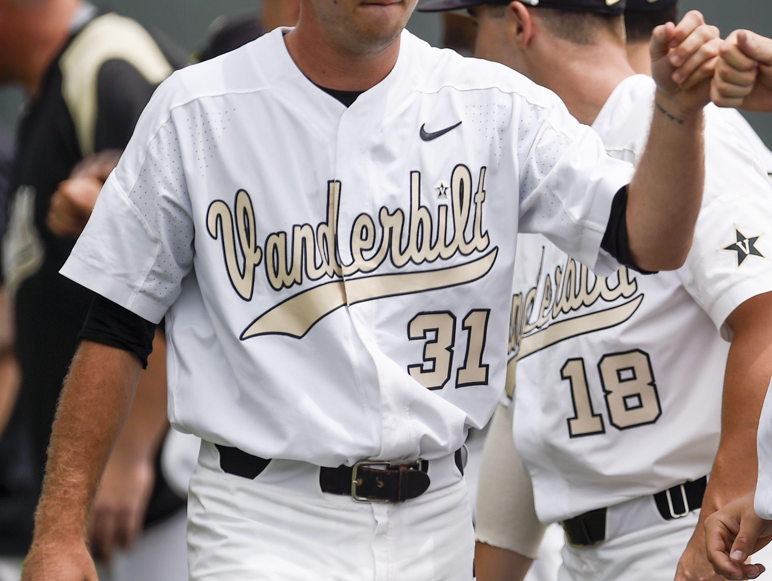 Vanderbilt pitcher Ryan Johnson (31) greets teammates before a NCAA Regional baseball game against Xavier at Hawkins Field, Saturday, June 4, 2016, in Nashville, Tenn.