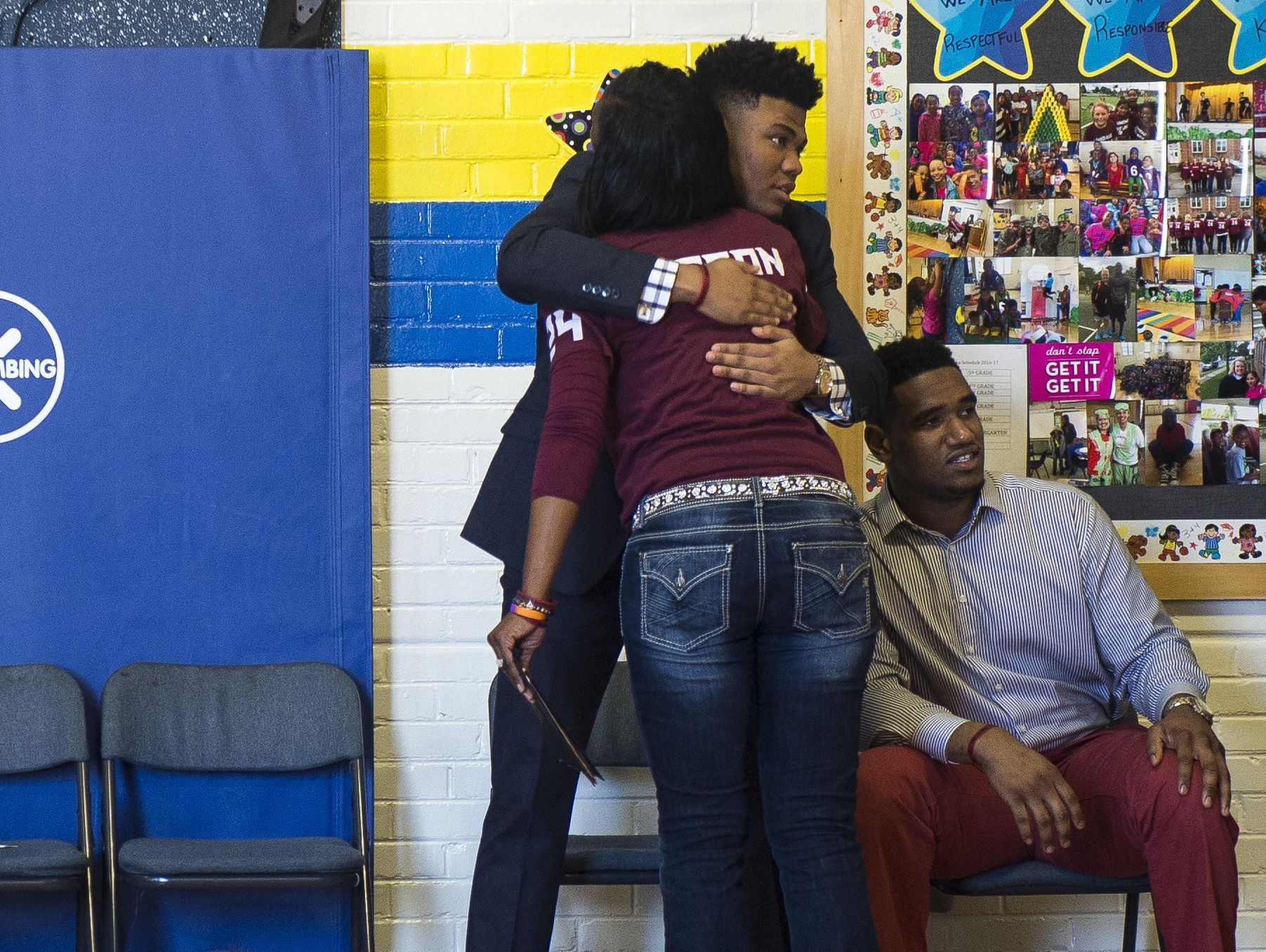 Zenobia Dobson, mother of Zaevion Dobson, receives a hug from Tennessee football player Todd Kelly, Jr. during the inaugural 'Zae Day' program held at Lonsdale Elementary on Tuesday.