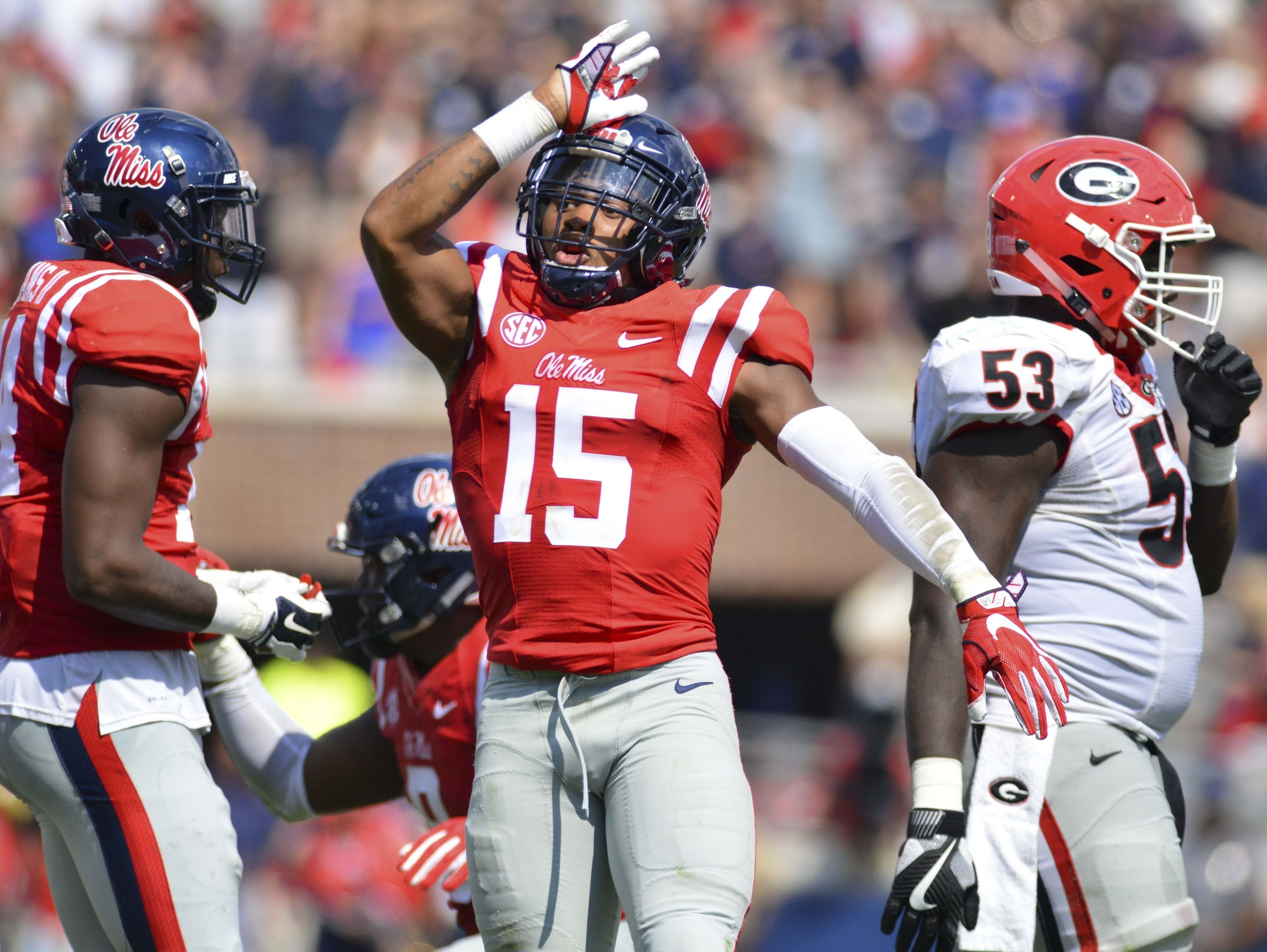 In this Sept. 24, 2016, file photo, Ole Miss defensive back Myles Hartsfield (15) makes the Landshark sign after a play during the second quarter of the game against Georgia