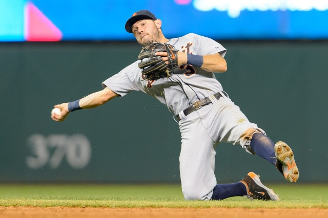 CLEVELAND, OH - SEPTEMBER 3: Second baseman Ian Kinsler #3 of the Detroit Tigers throws out Carlos Santana #41 of the Cleveland Indians at first during the sixth inning at Progressive Field on September 3, 2014 in Cleveland, Ohio. (Photo by Jason Miller/Getty Images)