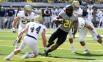 EUGENE, OR - SEPTEMBER 3: Running back Royce Freeman #21 of the Oregon Ducks runs past defensive back Zach Jones #44 of the UC Davis Aggies for aa touchdown during the first half of the game at Autzen Stadium on September 3, 2016 in Eugene, Oregon. (Photo by Steve Dykes/Getty Images)