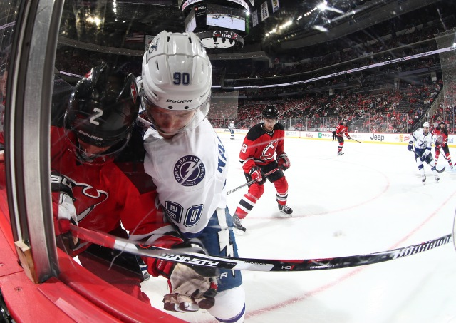 NEWARK, NJ - OCTOBER 29: John Moore #2 of the New Jersey Devils battles for the puck against Vladislav Namestnikov #90 of the Tampa Bay Lightning during their game at the Prudential Center on October 29, 2016 in Newark, New Jersey. (Photo by Al Bello/Getty Images)