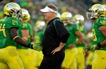 EUGENE, OR - SEPTEMBER 1: Head coach Chip Kelly of the Oregon Ducks talks to Kenjon Barner #24 during warm ups against the Arkansas State Red Wolves on September 1, 2012 at Autzen Stadium in Eugene, Oregon. Oregon won the game 57-34. (Photo by Craig Mitchelldyer/Getty Images)