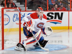 OTTAWA, ON - OCTOBER 11:  Goaltender Mike Condon #39 of the Montreal Canadiens protects his net and wins his first ever NHL game against the Ottawa Senators at Canadian Tire Centre on October 11, 2015 in Ottawa, Ontario, Canada. The Montreal Canadiens defeated the Ottawa Senators 3-1.  (Photo by Minas Panagiotakis/Getty Images)