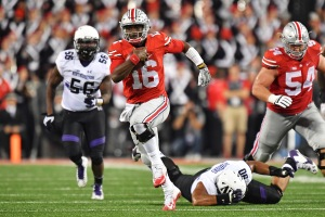 COLUMBUS, OH - OCTOBER 29: Quarterback J.T. Barrett #16 of the Ohio State Buckeyes breaks free for a 35-yard run in the fourth quarter against the Northwestern Wildcats at Ohio Stadium on October 29, 2016 in Columbus, Ohio. Ohio State defeated Northwestern 24-20. (Photo by Jamie Sabau/Getty Images)