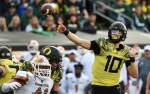 EUGENE, OR - OCTOBER 29: Quarterback Justin Herbert #10 of the Oregon Ducks passes the ball during the third quarter of the game against the Arizona State Sun Devils at Autzen Stadium on October 29, 2016 in Eugene, Oregon. (Photo by Steve Dykes/Getty Images)