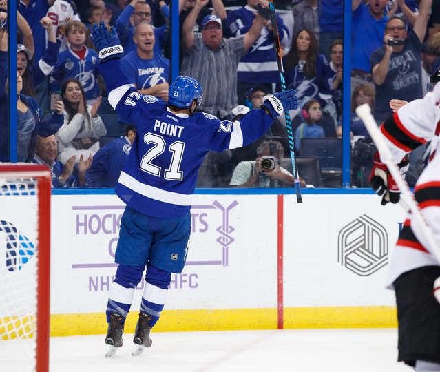 TAMPA, FL - NOVEMBER 5: Brayden Point #21 of the Tampa Bay Lightning celebrates his first NHL goal against the New Jersey Devils during the third period at Amalie Arena on November 5, 2016 in Tampa, Florida. (Photo by Scott Audette/NHLI via Getty Images)
