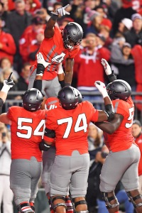 COLUMBUS, OH - NOVEMBER 5: Curtis Samuel #4 of the Ohio State Buckeyes celebrates in the end zone with Billy Price #54, Jamarco Jones #74 and Isaiah Prince #59, all of the Ohio State Buckeyes, after scoring on a one-yard touchdown reception at the end of the second quarter against the Nebraska Cornhuskers at Ohio Stadium on November 5, 2016 in Columbus, Ohio. (Photo by Jamie Sabau/Getty Images)