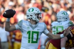 LOS ANGELES, CA - NOVEMBER 05: Justin Herbert #10 of the Oregon Ducks looks to pass against the USC Trojans at Los Angeles Memorial Coliseum on November 5, 2016 in Los Angeles, California. (Photo by Lisa Blumenfeld/Getty Images)