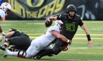 EUGENE, OR - NOVEMBER 12: Quarterback Justin Herbert #10 of the Oregon Ducks is tackled as he scrambles out of the pocket during the second quarter of the game against the Stanford Cardinal at Autzen Stadium on November 12, 2016 in Eugene, Oregon. (Photo by Steve Dykes/Getty Images)