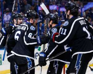 TAMPA, FL - NOVEMBER 12: Anton Stralman #6 of the Tampa Bay Lightning celebrates his goal with teammates Cedric Paquette #13, J.T. Brown #23, and Brian Boyle #11 against the San Jose Sharks during the third period at Amalie Arena on November 12, 2016 in Tampa, Florida. (Photo by Scott Audette/NHLI via Getty Images)