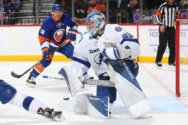 NEW YORK, NY - NOVEMBER 14: Andrei Vasilevskiy #88 of the Tampa Bay Lightning makes a save against the New York Islanders as Ryan Strome #18 of the New York Islanders looks on at the Barclays Center on November 14, 2016 in Brooklyn borough of New York City. (Photo by Mike Stobe/NHLI via Getty Images)