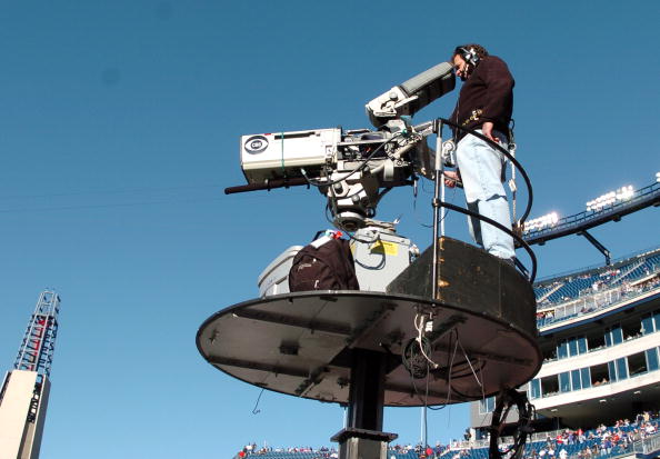 A CBS camera follows play as the New England Patriots host the New York Jets in an NFL wild card playoff game Jan. 7, 2007 in Foxborough. The Pats won 37 - 16. (Photo by Al Messerschmidt/Getty Images)