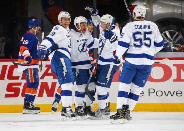 NEW YORK, NY - NOVEMBER 14: J.T. Brown #23 of the Tampa Bay Lightning celebrates his first period goal against the New York Islanders with teammates Braydon Coburn #55 and Slater Koekkoek #29 at the Barclays Center on November 14, 2016 in Brooklyn borough of New York City. (Photo by Mike Stobe/NHLI via Getty Images)