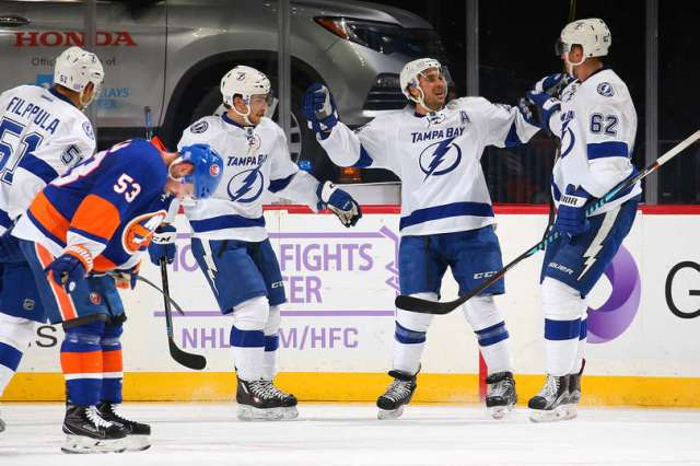 NEW YORK, NY - NOVEMBER 14: Ryan Callahan #24 of the Tampa Bay Lightning celebrates his first period goal against the New York Islanders with teammates Andrej Sustr #62 and Brayden Point #21 at the Barclays Center on November 14, 2016 in Brooklyn borough of New York City. (Photo by Mike Stobe/NHLI via Getty Images)