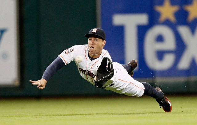 HOUSTON, TX - JUNE 29:  George Springer #4 of the Houston Astros makes a diving catch on al ine drive by Lorenzo Cain #6 of the Kansas City Royals in the third inning at Minute Maid Park on June 29, 2015 in Houston, Texas.  (Photo by Bob Levey/Getty Images)