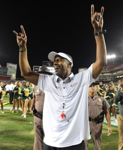 TAMPA, FL - NOVEMBER 14: Willie Taggart, head coach for South Florida Bulls celebrates the teams win against the Temple Owls at Raymond James Stadium on November 14, 2015 in Tampa, Florida. (Photo by Cliff McBride/Getty Images)