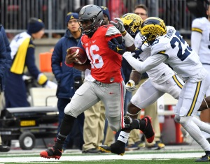 COLUMBUS, OH - NOVEMBER 26: J.T. Barrett #16 of the Ohio State Buckeyes rushes the ball during overtime against the Michigan Wolverines at Ohio Stadium on November 26, 2016 in Columbus, Ohio. (Photo by Jamie Sabau/Getty Images)