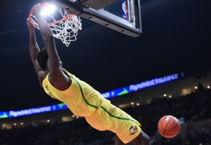 PORTLAND, OR - DECEMBER 17: Jordan Bell #1 of the Oregon Ducks dunks the ball during the first half of the game against the UNLV Rebels at the Moda Center on December 17, 2016 in Portland, Oregon. The Ducks won the game 83-63. (Photo by Steve Dykes/Getty Images)