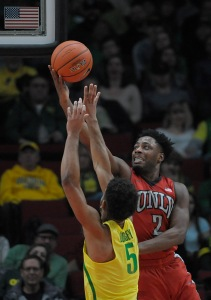 PORTLAND, OR - DECEMBER 17: Uche Ofoegbu #2 of the UNLV Rebels drives to the basket on Tyler Dorsey #5 of the Oregon Ducks during the first half of the game at Moda Center on December 17, 2016 in Portland, Oregon. The Ducks won the game 83-63. (Photo by Steve Dykes/Getty Images)