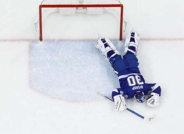 TAMPA, FL - DECEMBER 20: Goalie Ben Bishop #30 of the Tampa Bay Lightning lays on the ice against the Detroit Red Wings after getting injured during the first period at Amalie Arena on December 20, 2016 in Tampa, Florida. (Photo by Scott Audette/NHLI via Getty Images)