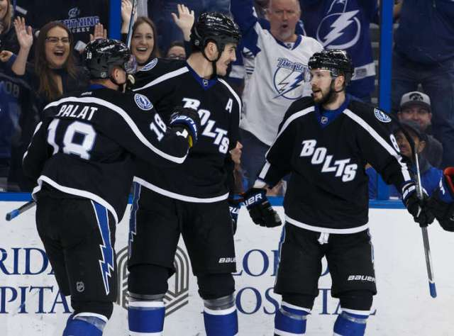 TAMPA, FL - DECEMBER 31: Brian Boyle #11 of the Tampa Bay Lightning celebrates his goal with teammates <a rel=