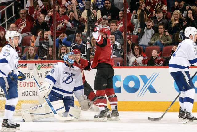 GLENDALE, AZ - JANUARY 21: Christian Fischer #36 of the Arizona Coyotes celebrates in front of goalie Ben Bishop #30 the Tampa Bay Lightning after scoring his first career NHL goal during the second period at Gila River Arena on January 21, 2017 in Glendale, Arizona. (Photo by Norm Hall/NHLI via Getty Images)