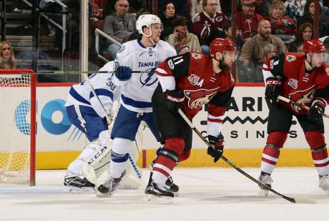 GLENDALE, AZ - JANUARY 21: Jake Dotchin #59 of the Tampa Bay Lightning and Martin Hanzal #11 of the Arizona Coyotes battle in front of the net during the first period at Gila River Arena on January 21, 2017 in Glendale, Arizona. The game marked Dotchin's first career NHL game. (Photo by Norm Hall/NHLI via Getty Images)