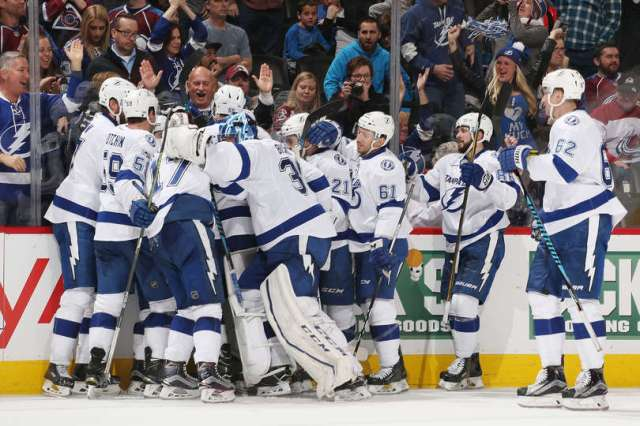 DENVER, CO - FEBRUARY 19: Members of the Tampa Bay Lightning celebrate an overtime goal against the Colorado Avalanche by Jonathan Drouin #27 at the Pepsi Center on February 19, 2017 in Denver, Colorado. The Lightning defeated the Avalanche 3-2 in overtime. (Photo by Michael Martin/NHLI via Getty Images)