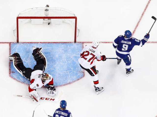 AMPA, FL - FEBRUARY 2: Tyler Johnson #9 of the Tampa Bay Lightning celebrates a goal against goalie Mike Condon #1 and Curtis Lazar #27 of the Ottawa Senators during the second period at Amalie Arena on February 2, 2017 in Tampa, Florida. (Photo by Mark LoMoglio/NHLI via Getty Images)