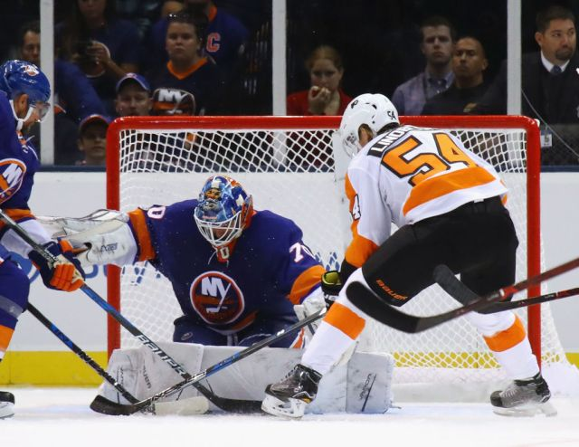 UNIONDALE, NY - SEPTEMBER 17: Kristers Gudlevskis #70 of the New York Islanders makes the first period save on Oskar Lindblom #54 of the Philadelphia Flyers during a preseason game at the Nassau Veterans Memorial Coliseum on September 17, 2017 in Uniondale, New York. (Photo by Bruce Bennett/Getty Images)