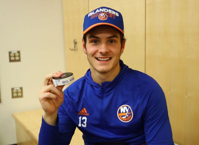 NEW YORK, NY - OCTOBER 19: Mathew Barzal #13 of the New York Islanders holds the puck with which he scored his first NHL goal against the New York Rangers at Madison Square Garden on October 19, 2017 in New York City. The Islanders defeated the Rangers 4-3 in the shootout. (Photo by Bruce Bennett/Getty Images)