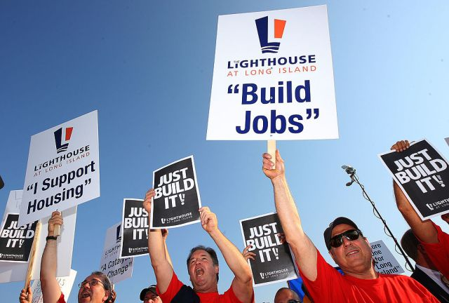 UNIONDALE, NY - AUGUST 04:  Members of Local 406 rally for support at Lot 8 of the Nassau Coliseum prior to marching to the Lighthouse project public hearing at the Adams Playhouse on the campus of Hofstra University on August 4, 2009  in Uniondale, New York.  (Photo by Mike Stobe/Getty Images)