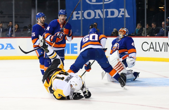Jan 5, 2018; Brooklyn, NY, USA; Pittsburgh Penguins right wing Daniel Sprong (41) is knocked to the ice after scoring a goal against the New York Islanders during the third period at Barclays Center. Mandatory Credit: Andy Marlin-USA TODAY Sports