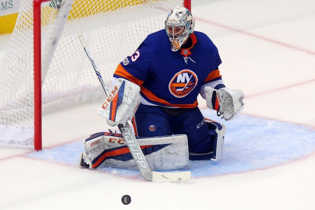 Sep 17, 2017; Uniondale, NY, USA; New York Islanders goalie Christopher Gibson (33) makes a save against the Philadelphia Flyers during the third period of a preseason game at NYCB Live at the Nassau Veterans Memorial Coliseum. Mandatory Credit: Brad Penner-USA TODAY Sports